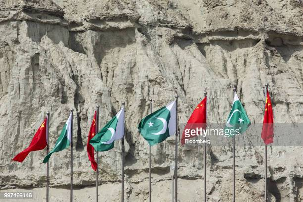 Chinese national flags fly next to Pakistani national flags at the Gwadar port in Gwadar in Balochistan Pakistan on Tuesday July 4 2018 What used to...