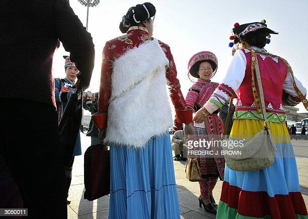 Chinese National People's Congress delegates greet one another in Beijing 07 March 2004 As the world marks International Women's Day 08 March the...