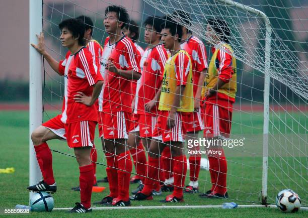 Chinese national soccer team captain Li Weifeng and his teammates attend a training session on October 6 2005 in Beijing China The session comes...