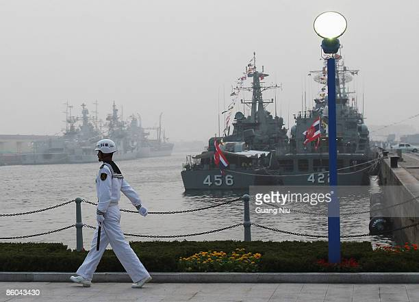 Chinese naval soldier gaurds in front of foreign warships at Qingdao Port on April 20 2009 in Qingdao of Shandong Province China China's navy is set...