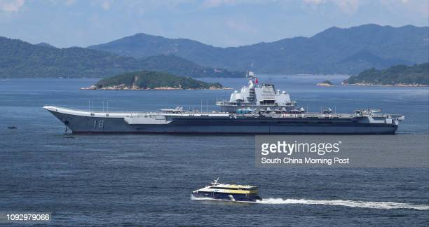 Chinese Navy Ship Type 001 aircraft carrier Liaoning departs from Hong Kong waters on Tuesday morning July 11, 2017. 11JUL17 SCMP / Roy Issa
