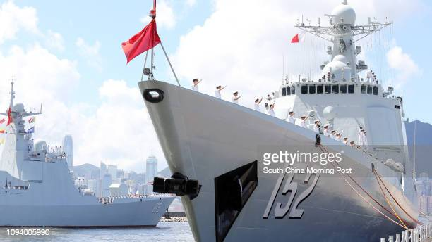 """Chinese navy Type 052C Luyang II class destroyer """"Jinan"""" and Type 052D Luyang III class destroyer """"Yinchuan"""" prepare to leave the Victoria Harbour...."""