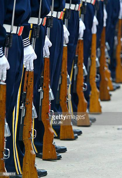 Chinese navy's honor guards in attention as the USS Blue Ridge arrives in Shanghai, 24 February 2004. The command ship of the US Navy's Seventh Fleet...