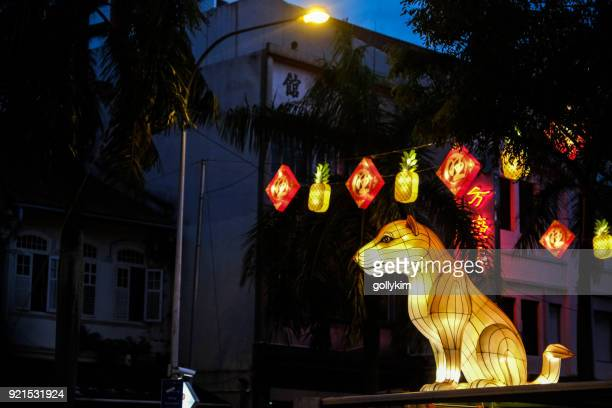 chinese new year decoration for the year of dog at singapore chinatown - shiba inu lights stock pictures, royalty-free photos & images