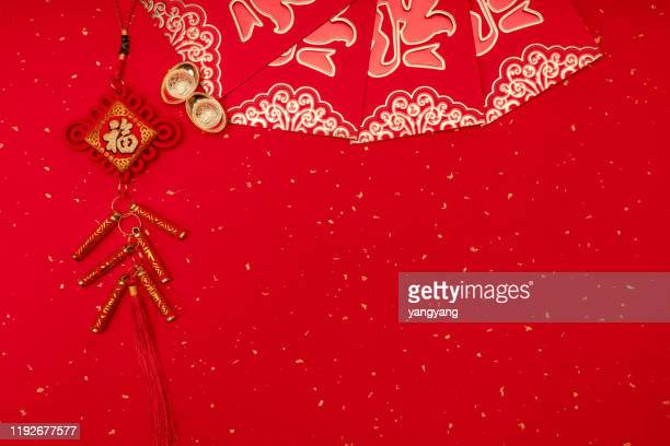 chinese new year decoration on a red background flag of good fortune and lump of gold - prosperity stock pictures, royalty-free photos & images