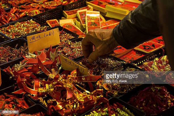 Chinese New Year decorations are displayed for sale inside a flower market on January 30 2016 in Taipei Taiwan The Chinese Lunar New Year also known...