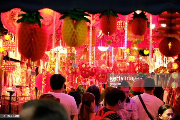 chinese new year decorations sold at the street vendors at singapore chinatown - lantern festival stock photos and pictures