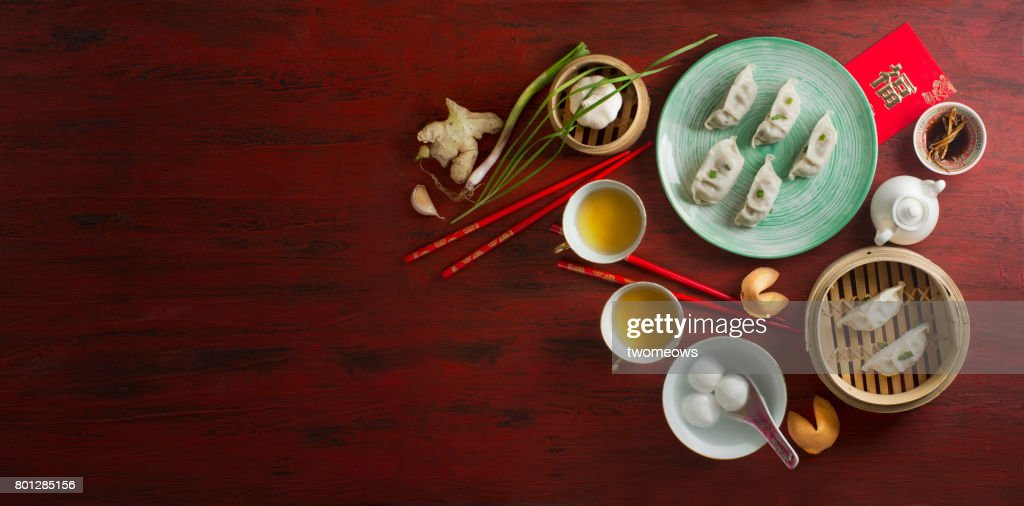 chinese new year food and drink on red rustic background stock photo