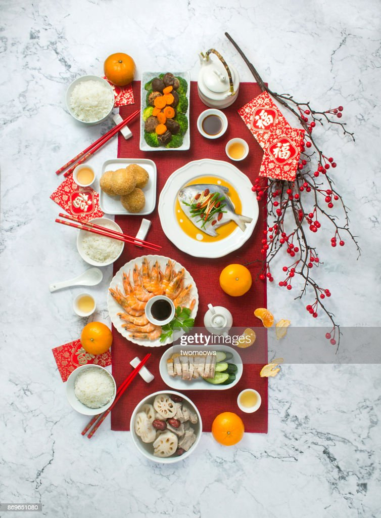 chinese new year food and drink reunion dinner still life stock photo - Chinese New Year Food