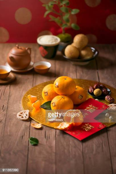 chinese new year food and drink still life. selective focus image. - fruit exotique photos et images de collection