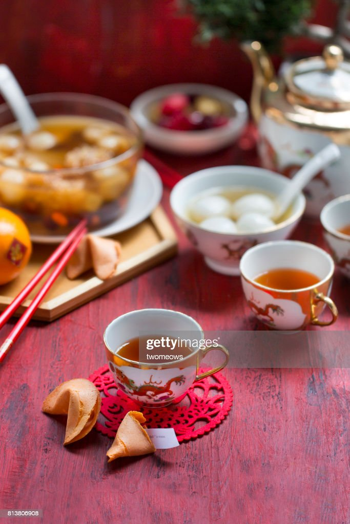 chinese new year food and drinks on red rustic background stock photo