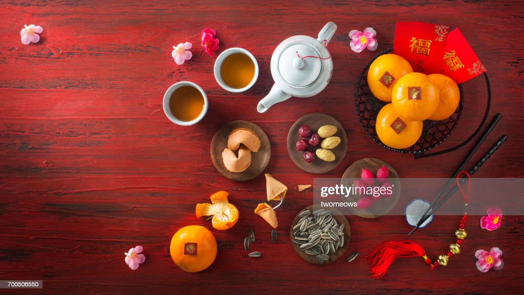 chinese new year food and drinks on red rustic wooden background stock photo