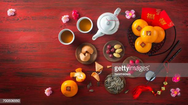 Chinese new year food and drinks on red rustic wooden background.