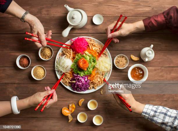 "chinese new year food, raw fish salad ""yusheng"". - chinese new year stock pictures, royalty-free photos & images"