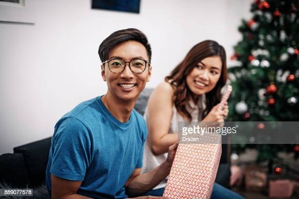 Chinese New Year in Australia, couple exchanging Christmas gifts