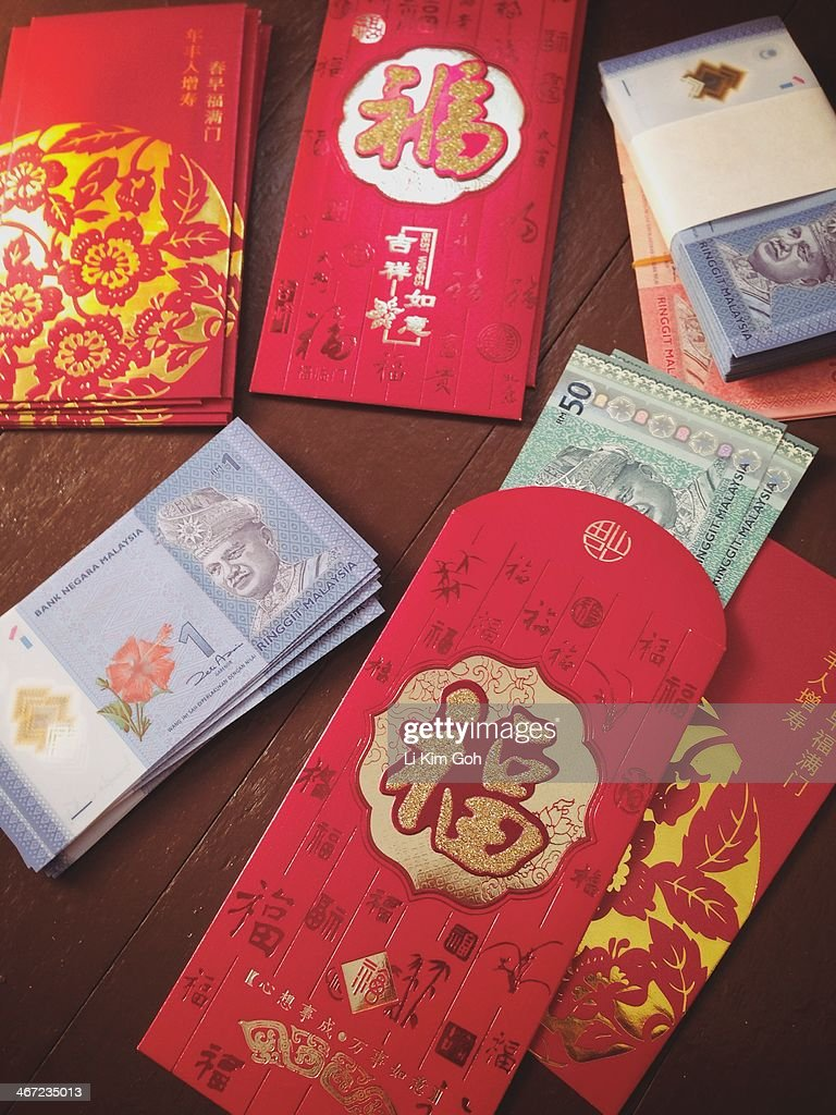 Chinese New Year Red Envelope Hong Bao filled with money, Malaysian currency