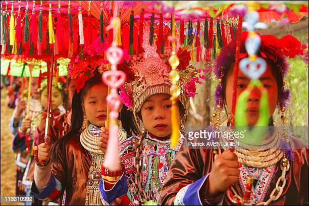 Chinese New Year, To The Sound Of The Lusheng - On February 11Th, 2005 - In China - Here, Procession Of Young Miao Women Dressed In Traditional...