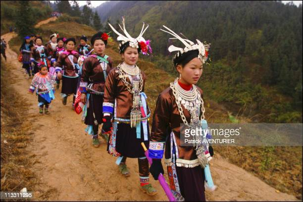 Chinese New Year To The Sound Of The Lusheng On February 11Th 2005 In China Here Young Women Dressed In The Traditional Miao Costume Adorned With...