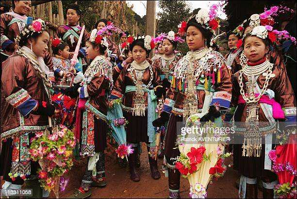 Chinese New Year To The Sound Of The Lusheng On February 2005 In China Here Young Women In Gaoliao Dressed In The Traditional Miao Costume And...