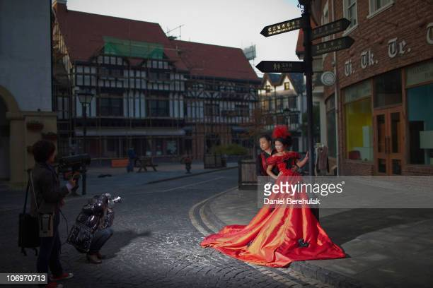 Chinese newlyweds pose for wedding photographs in Thames Town on November 19 2010 in Songjiang China Chinese wedding couples gather daily to have...