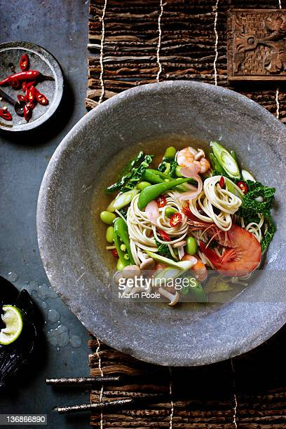 chinese noodles spring green broth - noodles stock pictures, royalty-free photos & images