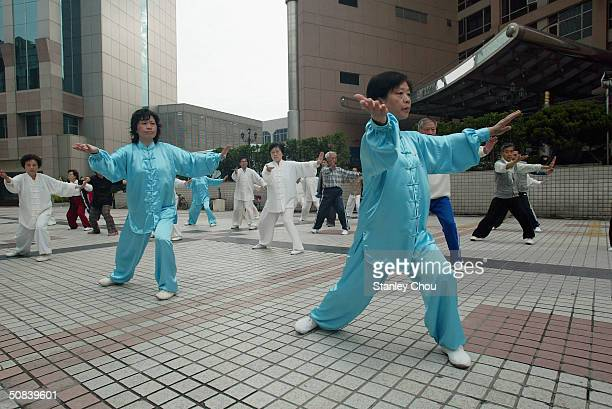 Chinese of Shanghai performs the Taichi martial arts at the Official Hotel during the BMW Asian Open Golf Championships on May 15 2004 in Pudong...