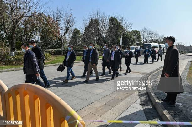 Chinese officials depart following a meeting with the World Health Organization team investigating the origins of the Covid-19 pandemic at the Hilton...