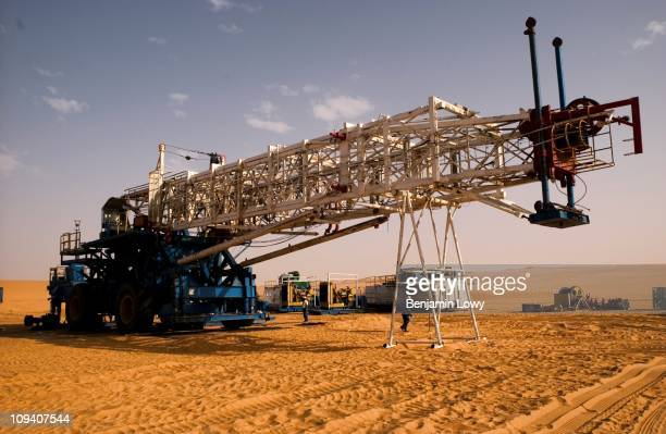 Chinese oil drilling team working for Repsol begins the task of assembling a massive drilling rig in the middle of the desert on June 5 2004 in...