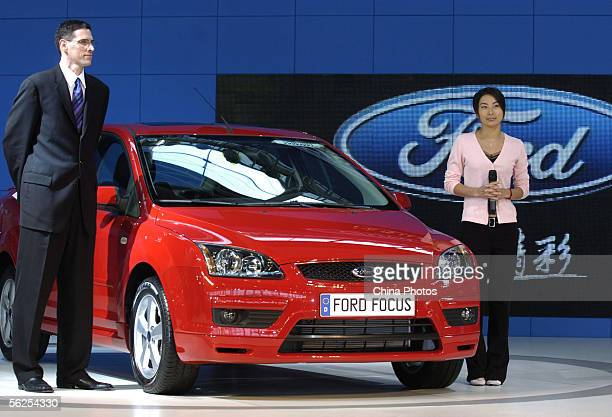 Chinese Olympic diving champion Guo Jingjing attends a ceremony to launch the Ford Focus car at the 3rd China International Automobile Exhibition on...