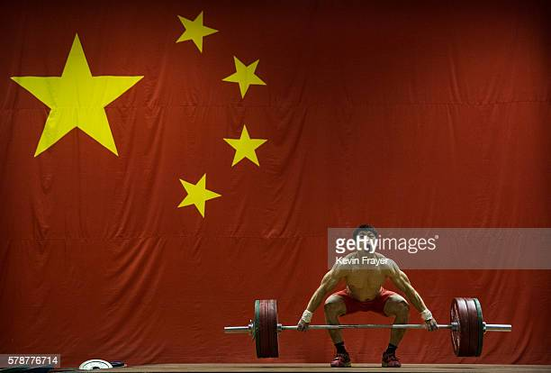 Chinese Olympic weightlifter Chen Lijun 62kg weightclass lifts during a training session at the Training Center of General Administration of Sports...