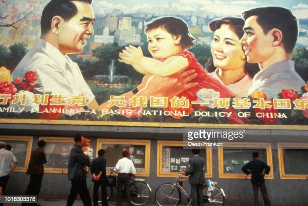 Chinese One Child Family Planning sign, in 1985 in Chengdu, China - to the left, former Premier Zhou Enlai