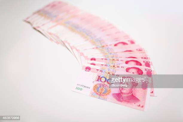 Chinese one hundred yuan banknotes are arranged for a photograph at a Hang Seng Bank Ltd branch in Hong Kong China on Wednesday July 23 2014 Hang...