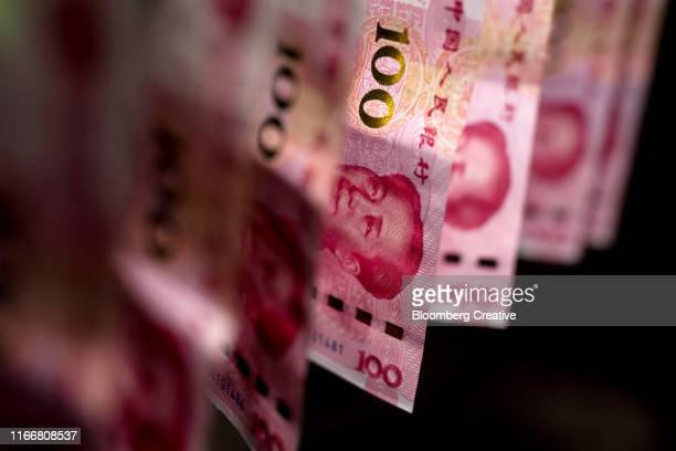chinese one hundred yuan banknotes on black background - chinese currency stock pictures, royalty-free photos & images