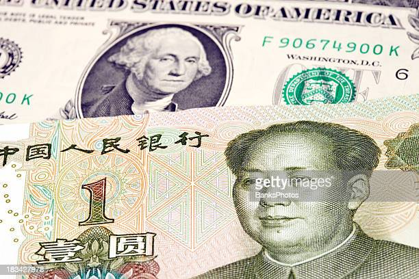 chinese one yuan rests on top of us dollar - mao tsé toung stockfoto's en -beelden