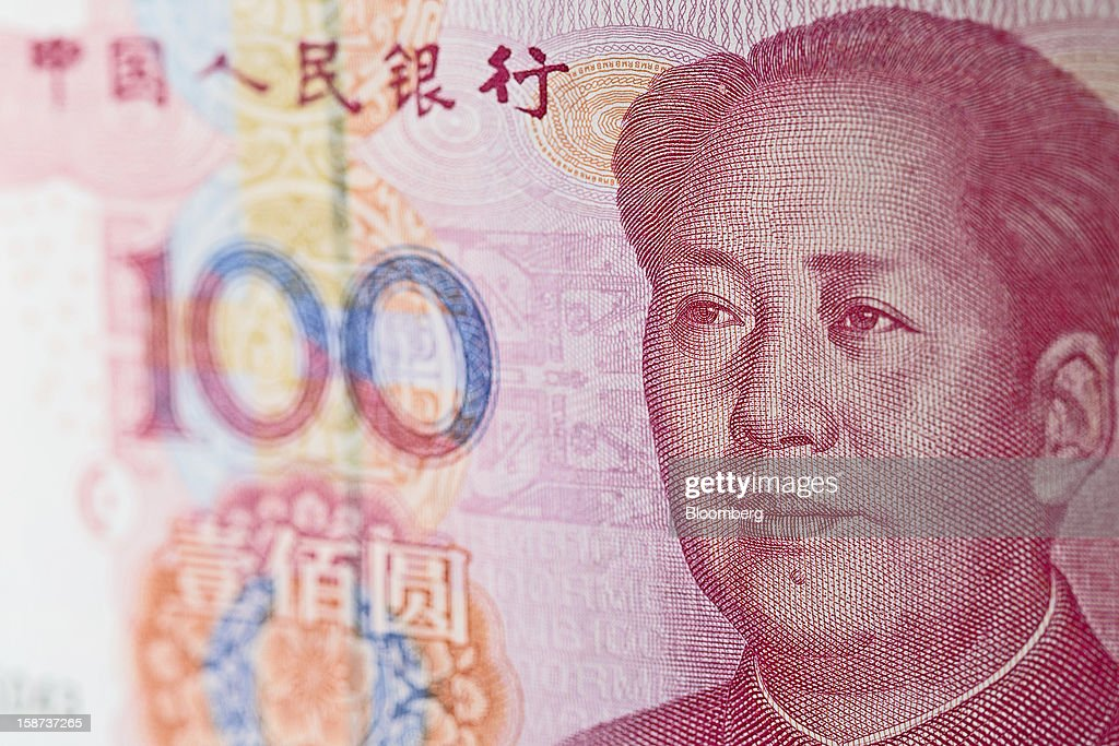 A Chinese one-hundred yuan banknote is arranged for a photograph in Hong Kong, China, on Wednesday, Dec. 26, 2012. China's yuan fell for a fourth day after the central bank set the currency's reference rate at a five-week low amid concern budget deficits in advanced nations will hurt the global economy. Photographer: Jerome Favre/Bloomberg via Getty Images