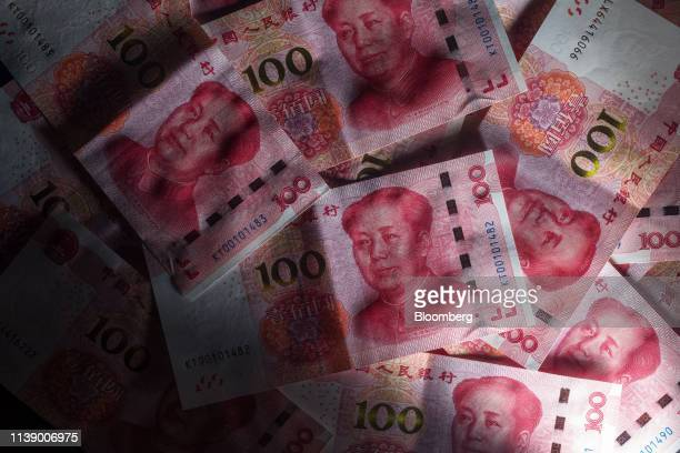 Chinese one-hundred yuan banknotes are arranged for a photograph in Hong Kong, China, on Monday, April 15, 2019. China's holdings of Treasury...