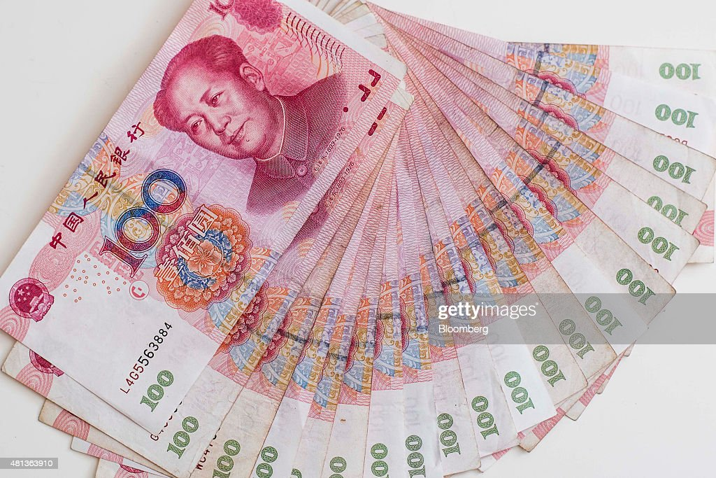 Chinese one-hundred yuan banknotes are arranged for a photograph in Hong Kong, China, on Monday, July 20, 2015. The yuan has proven to be among the more resilient emerging-market currencies this year, having fallen less than 0.1 percent versus the dollar as China cut interest rates and the U.S. prepared to raise. Photographer: Xaume Olleros/Bloomberg via Getty Images
