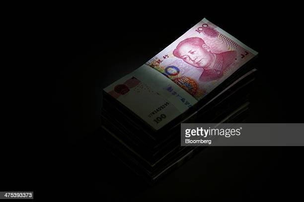 Chinese onehundred yuan banknotes are stacked for a photograph at the Korea Exchange Bank headquarters in Seoul South Korea on Thursday Feb 27 2014...