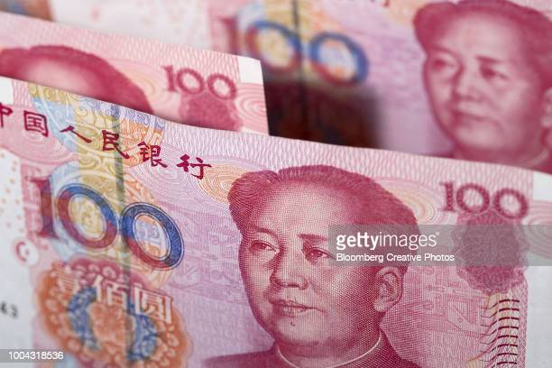 chinese one-hundred yuan banknotes - chinese currency stock pictures, royalty-free photos & images