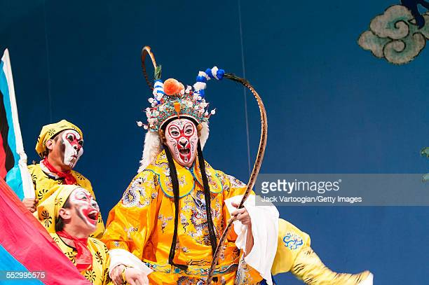 Chinese opera actor Ding Meikui of the Qi Shu Fang Peking Opera Company performs in 'The Monkey King Havoc in Imperial Stables' at a World Music...