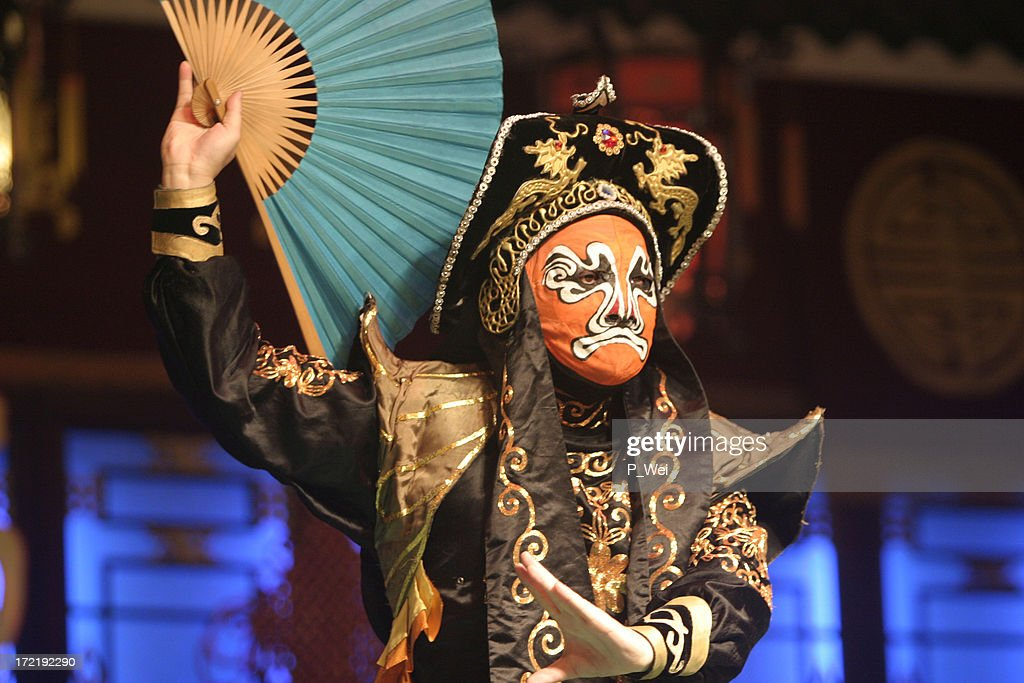A Chinese opera actor performing with a mask on : Stock Photo