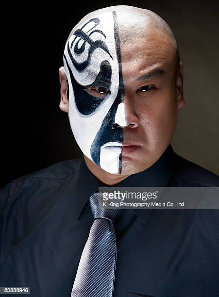 Chinese opera actor with makeup on half of face