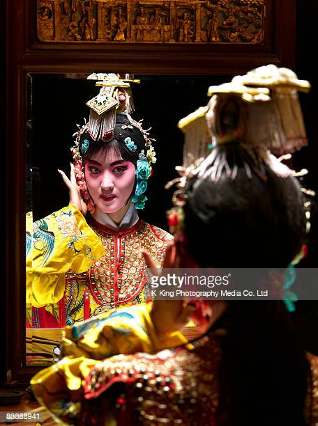 Chinese opera character looking in mirror (Yu Ji)