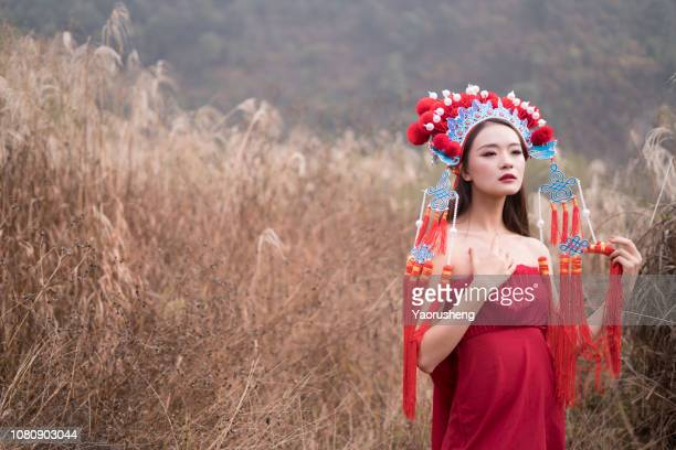 Chinese opera performer in the fall outdoor grass field