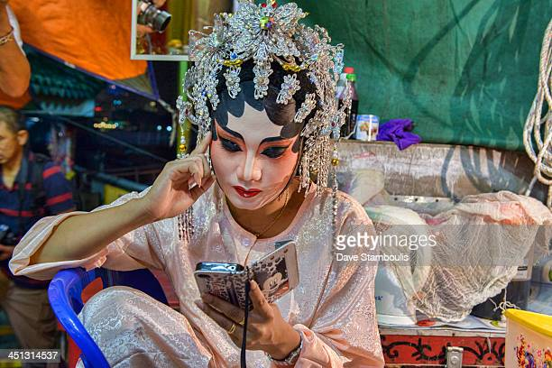 Chinese opera performer prepares for a performance at the Vegetarian Festival in Bangkok, Thailand