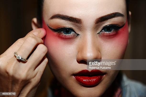 Chinese opera performer puts on makeup before The Beauty of China Opera show at Pakuwon Bllroom on January 30 2014 in Surabaya Indonesia Chinese...