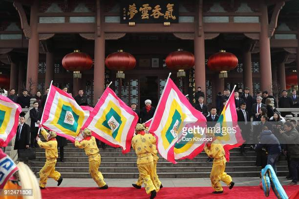 Chinese Opera performers entertain British Prime Minister Theresa May and her husband Philip May as part of a cultural event at the Yellow Crane...