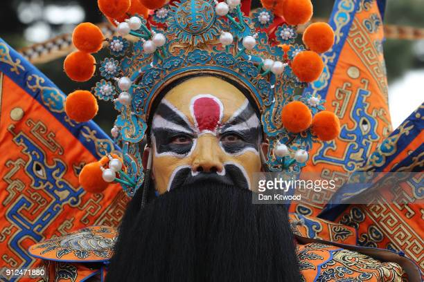 Chinese Opera performers wait to entertain British Prime Minister Theresa May and her husband Philip May as part of a cultural event at the Yellow...