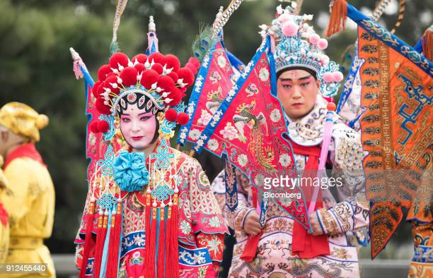 Chinese opera performers wait to perform for UK Prime Minister Theresa May not pictured at the Yellow Crane Tower in Wuhan China on Wednesday Jan 31...