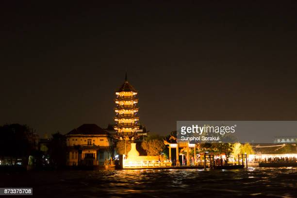 A chinese pagoda along the side of Chao Praya river
